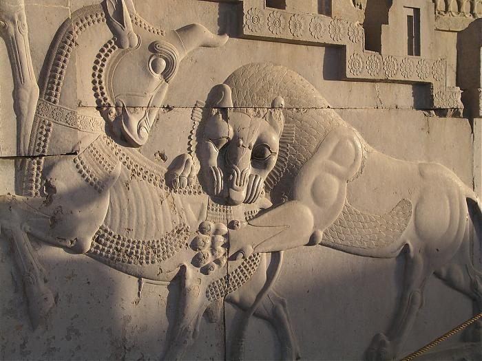 Persepolis bas relief carving of lion and bull in combat