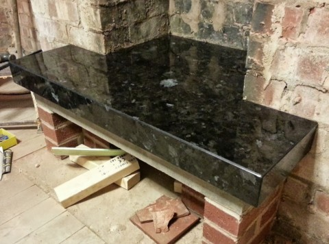 Fabricated granite fire hearth in antique brown
